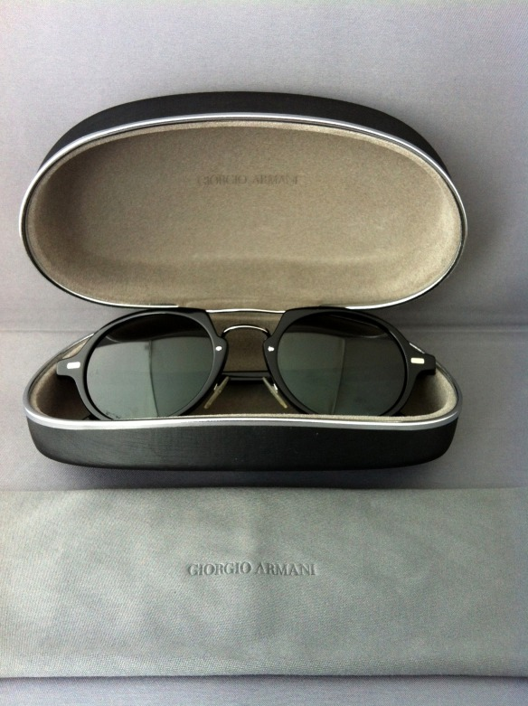 A brand new pair of last-season Giorgio Armani sunglasses with original cloth and case