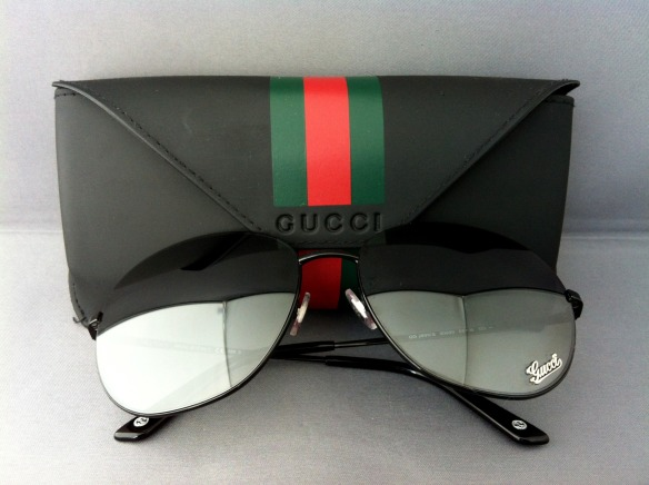A brand new pair of last-season Gucci sunglasses with case